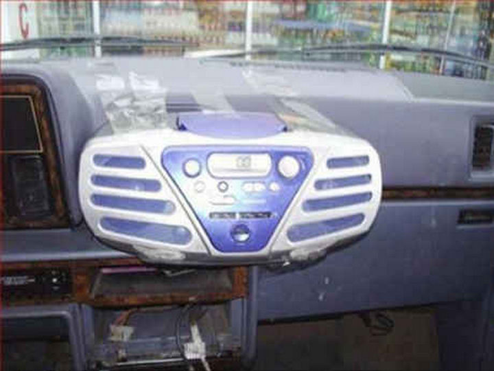 18 Funny Life Hacks - Add a new in-dash CD player.