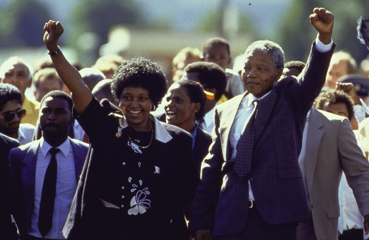 22 Timeless Images - Nelson Mandela and wife Winnie raising their fists in unity upon his release from prison (1990).