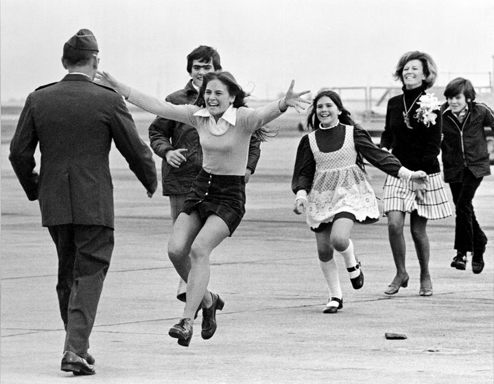 22 Timeless Images - A released prisoner of the Vietnam War gets reunited with his family in Fairfield, California (1973).