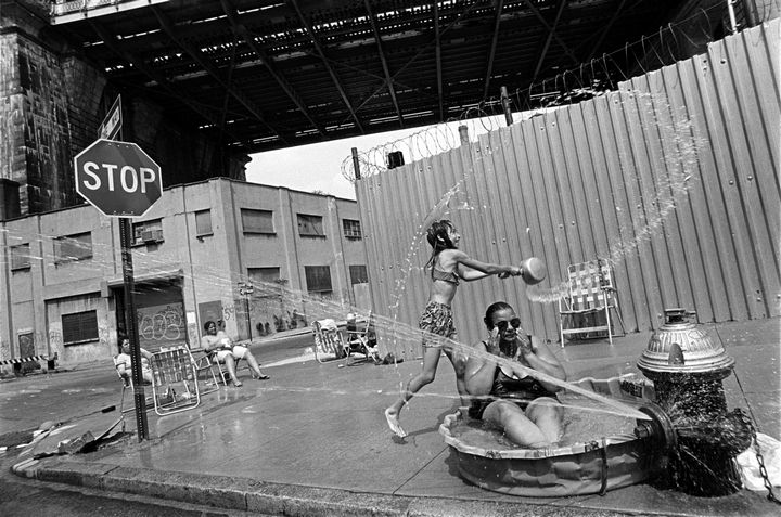 22 Timeless Images - A grandmother beats the heat in a plastic kiddie pool beneath the Manhattan Bridge (1993).