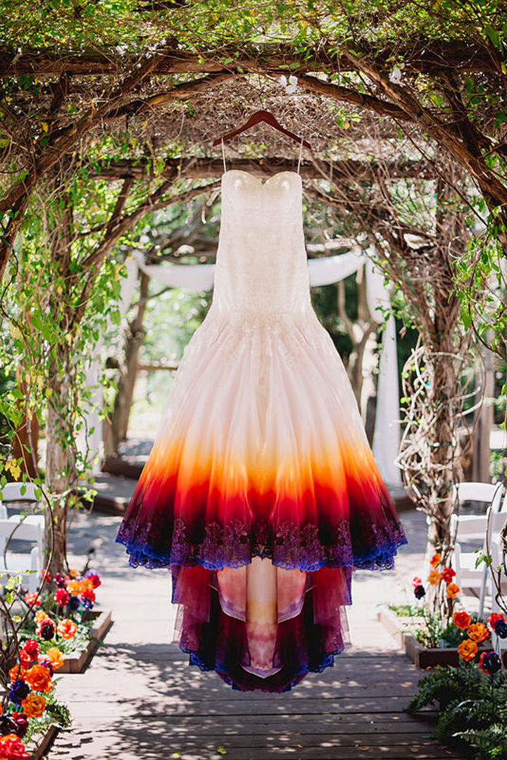 She found a wedding dress at a discount store and decided to airbrush it with 3 layers of paint and it looks gorgeous.