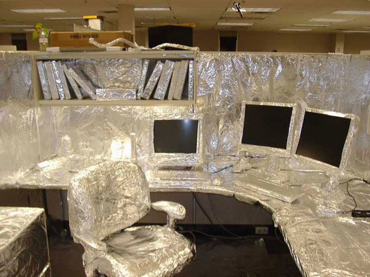 26 Funny Office Pranks - This foil covered cubicle still lets you see the monitor.