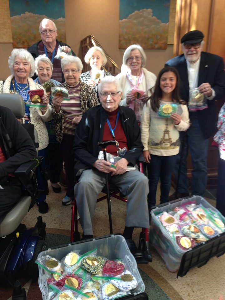 Ed Moseley knitted over 50 knitted hats for preemies and inspired his friends to do the same.