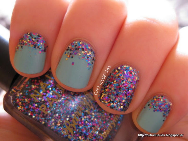 Super cute and fun glitter reverse gradient nails with full glitter accent nail.