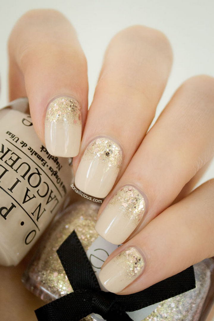 Golden Hour reverse glitter gradient nails inspired by the opulence of Abu Dhabi and Dubai.