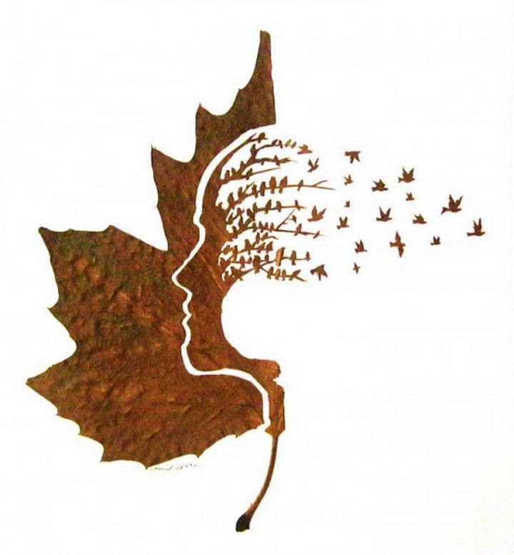 A striking piece with birds taking flight from a tree.
