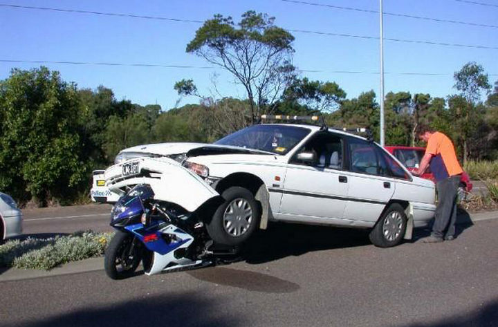 25 People Having a Really Bad Day - When you're looking for a parking spot but fail to notice the parked motorbike.