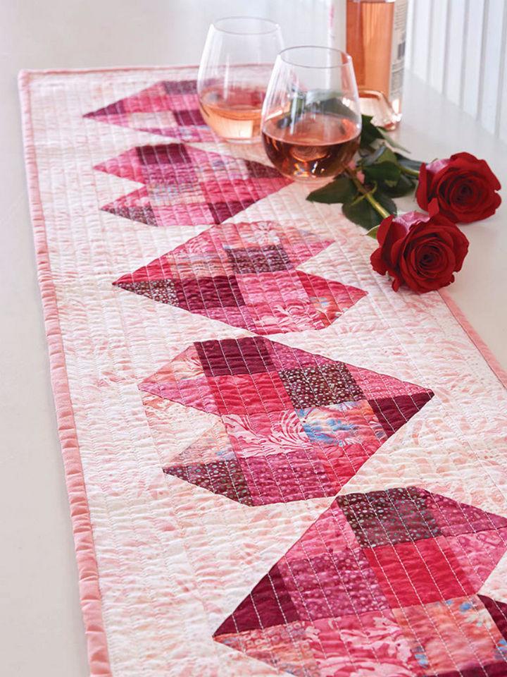 27 DIY Valentine's Day Crafts - Make a heart table runner quilt.