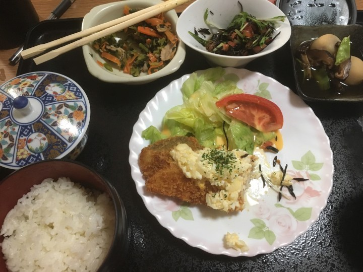 Fried fish with tartar sauce, braised mountain potatoes, hijiki salad, spinach and carrot stir fry, rice, and green tea.