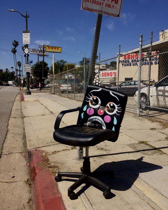 Sad broken and unwanted desk chair.