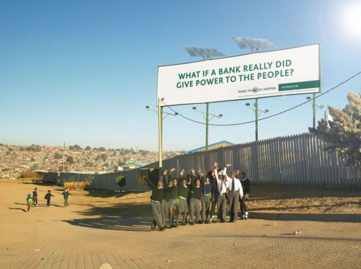 27 Awesome Billboards - Nedbank literally gives power to the people with a billboard with solar panels. The solar-powered billboard generates electricity for a small township in Africa as well as for the billboard illumination.