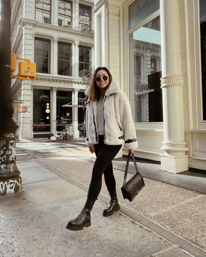 Wear faux fur like New York City-based influencer Alyssa Lenore who paired a light-colored jacket with some dark jeans.