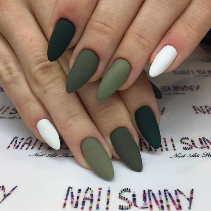 Matte green almond nails.
