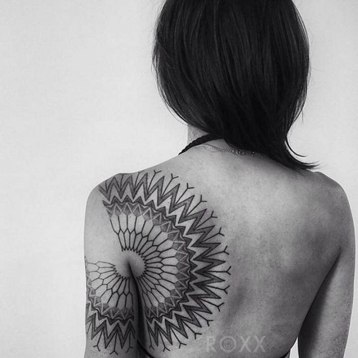 Making a bold statement with a back tattoo.