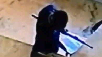 Photo of Nigeria Civil defence officer caught on CCTV stealing money from a purse (video)