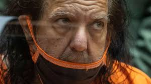 Photo of Adult film star Ron Jeremy pleads not guilty to raping 3 women, sexually assaulting a 4th