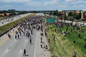 Photo of Demonstrators protesting the death of Elijah McClain shut down Colorado highway