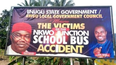 Enugu Local Govt chairman puts up huge billboard with his smiling photo to mourn victims of tragic school bus crash