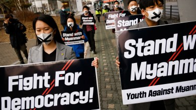 People march towards the Myanmar embassy during a protest in solidarity with Myanmar democracy in Seoul