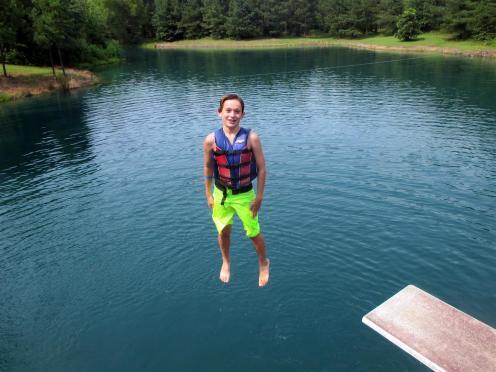 Tom's~099-Jack_is_standing_on_Bear_Paw_Lake