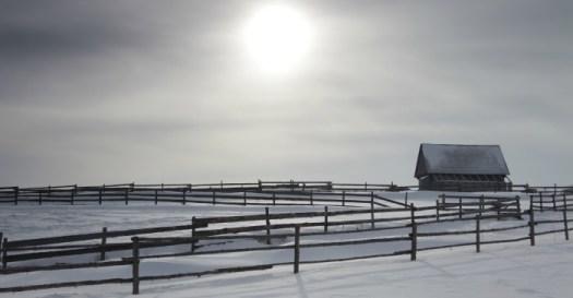 snow light over barn
