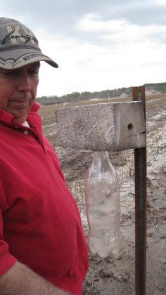 Bill checks the Carpenter Bee traps