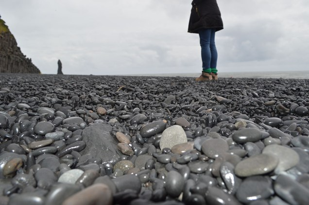 black sand comes from these black rocks :)