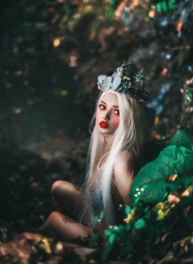 selective focus photography of woman wearing crown