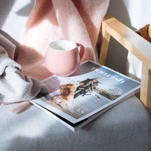 pink mug and magazine
