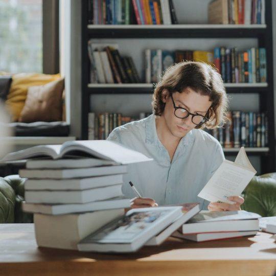man in white dress shirt reading book; beta reader