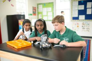 students working with robotics