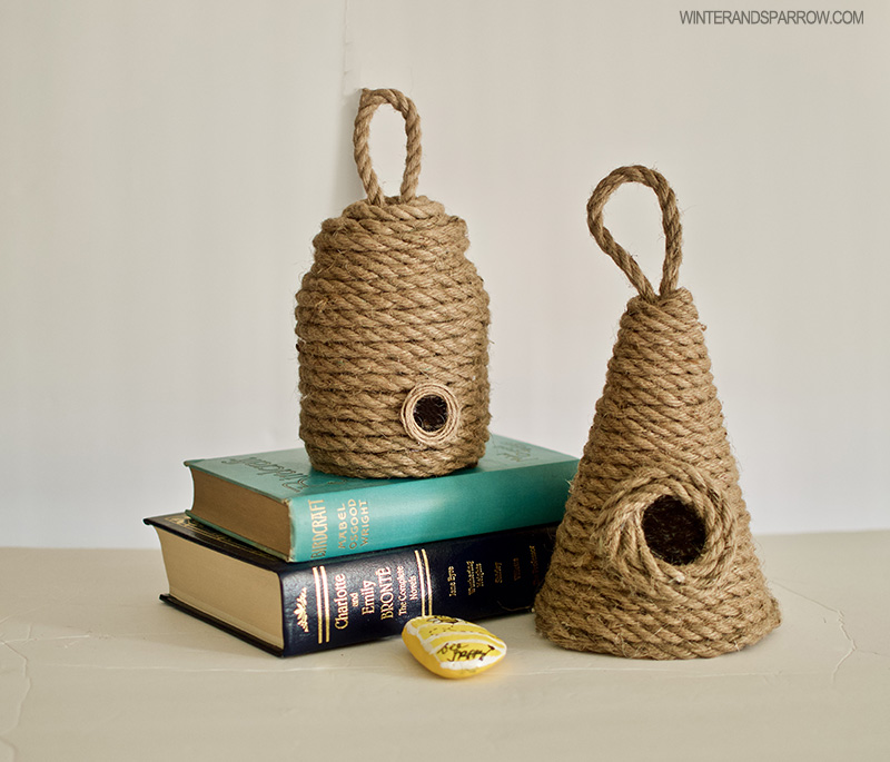 Two hand made bee skeps featured on a set of books.