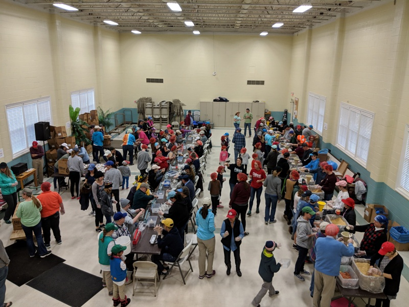 "A photo from a ""Rise Against Hunger"" food packing event at WPPC."