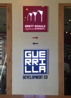 A pair of matching, low-profile back-lighted signs for Guerrilla Development and Brett Schulz Architect.