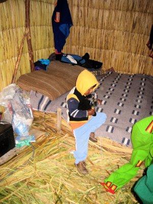 boy playing inside hut