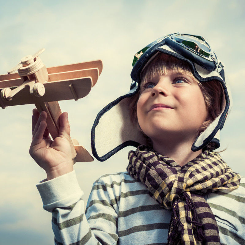 Pilot with airplane on a background of sky