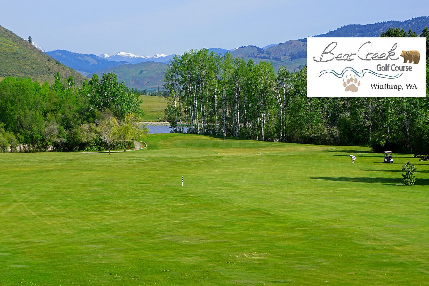 lush green golf course with mountains in the background