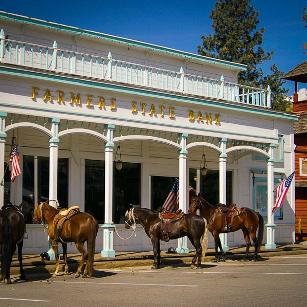 horses lined up in front of old west town bank Winthrop Washington