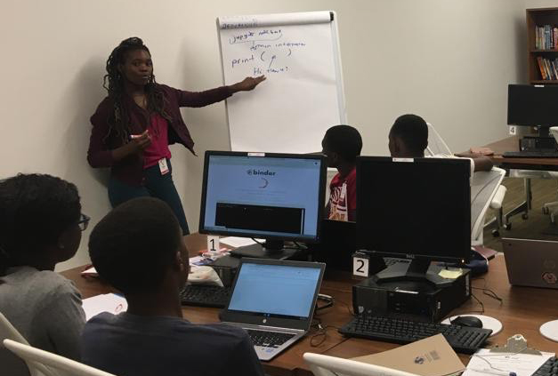 Pelagia teaching some of her students in Zimbabwe.