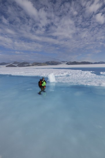 Jill waist deep in the frigid waters for science! She swears her GPS point was around there somewhere.