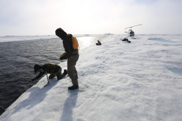 CTD profiling and ice thickness measuring out on open Arctic Ocean waters beyond the Milne Ice Shelf.