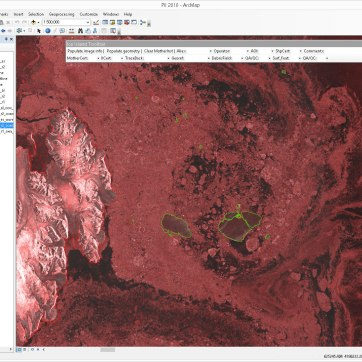 A screenshot of the digitizing work environment in ArcMap (ESRI) and ice islands (green outlines) in northern Baffin Bay on October 9, 2010. A custom toolbar includes access to the fields required for data entry. Ice island PII-A (74 km2) is on the left while ice island PII-B (right) has just broken into 3 fragments: PII-B (85 km2), PII-B-a (33 km2) and PII-B-b (11 km2). Radarsat-2 data and products © MacDonald, Dettwiler and Associates Ltd., 2010 – All Rights Reserved.