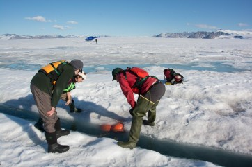 The team assessing the situation of Jill's mooring that had partially frozen in over winter.