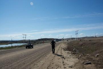 Greg walking along the roads of Iqaluit, NU.