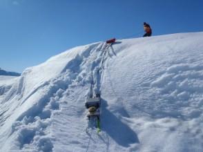 Carefully lowering an ice penetrating radar system on the Mlne Ice Shelf