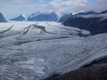 Up-glacier shot of the Milne Glacier with a tributary glacier roughly flowing in.