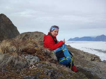 Kelly Graves having a quick snack along the top of a ridge overlooking the Milne Glacier.