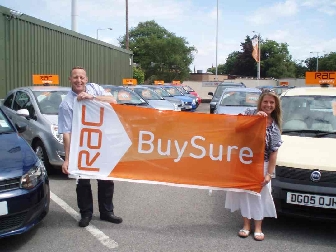 Paul & Roz Celebrate being awarded RAC official 'Approved Dealer' and 'RAC BuySure' status.