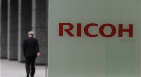 A man walks in front of the headquarters of Ricoh Co in Tokyo May 26, 2011.  REUTERS/Toru Hanai