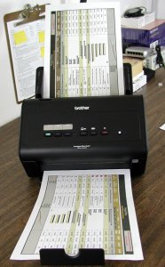 The Brother ImageCenter ADS-3000N as tested, shown with legal-sized originals in the input and output trays.